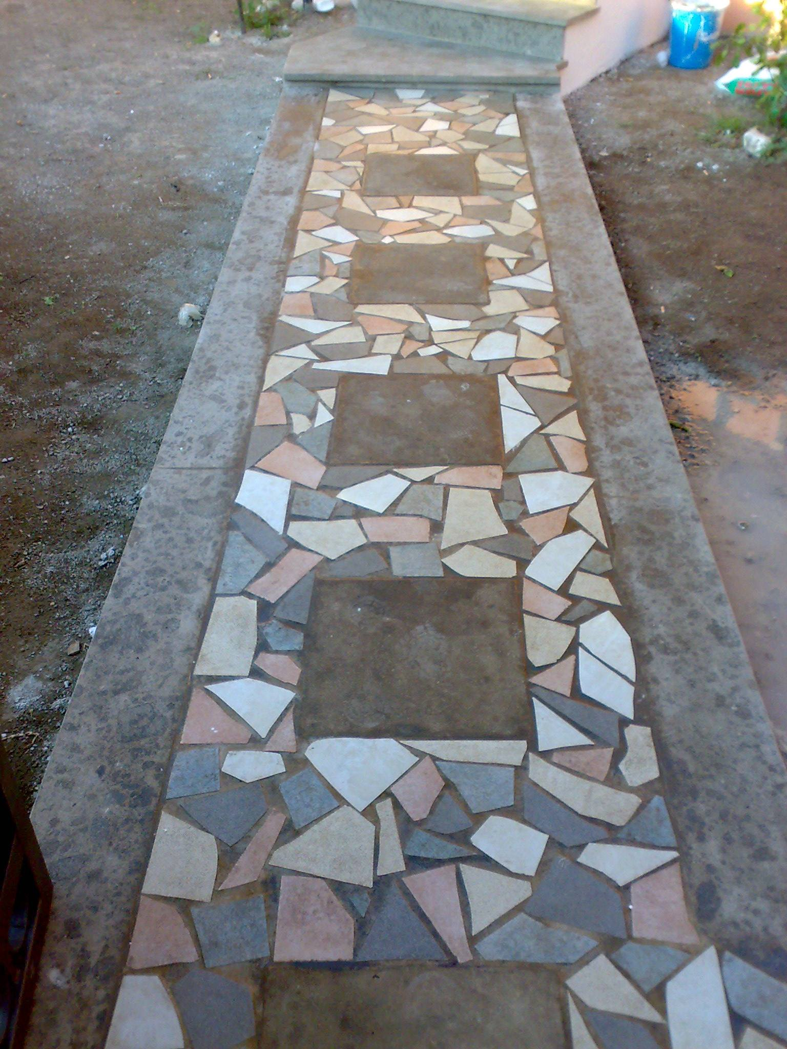 Pavimento in pietra e mosaico